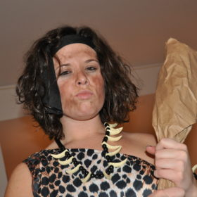 A woman dressed as a cavewoman