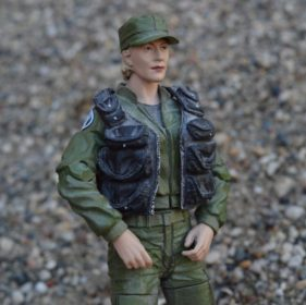 female toy solider in battle dress